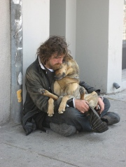 homeless_man_cuddling_dog_0