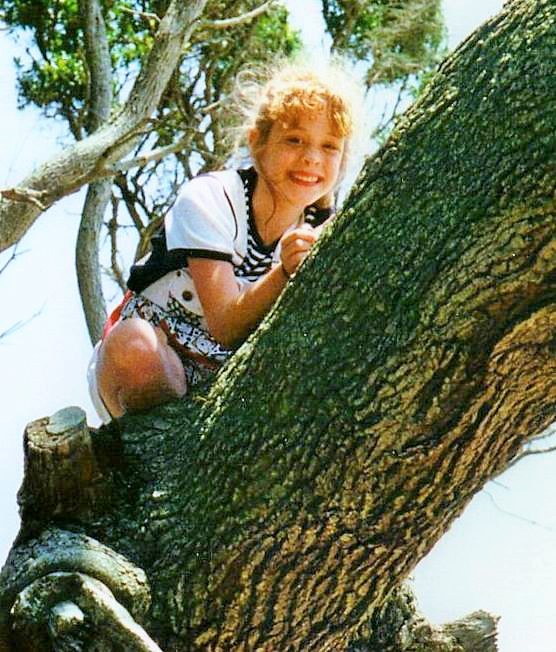 Beth and her smile climbs a tree...years ago!