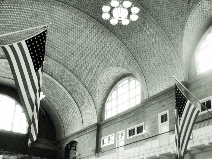 Inside building on Ellis Island. This is where the immigrants congregated after leaving their ships.