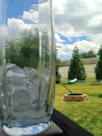 Fire Pit & Hammock with a Larger Than Life Glass of Water